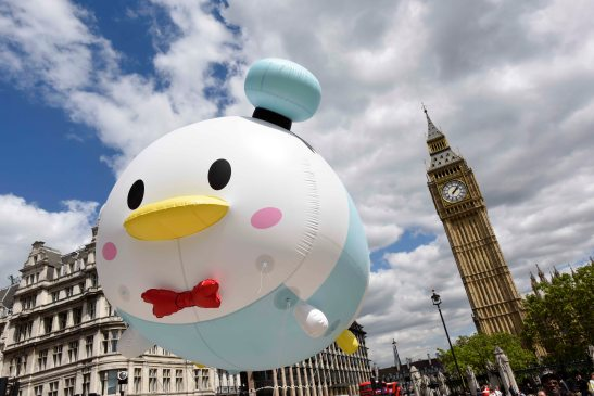 """Copyright STEWART WILLIAMS 07956 568150 DISNEY 'TSUM TSUM' TOY CRAZE JUST GOT BIGGER Giant Disney characters in the shape of """"TSUM TSUMS """", the latest collectible toy craze to hit the UK from Japan, journeyed through London on their way to Disney Store on Oxford Street. (FREE TO USE)"""