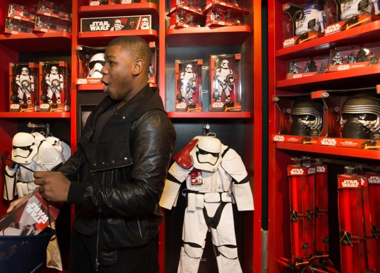 John Boyega star of Star Wars:The Force Awakens inside the Disney Store on London's Oxford Street ahead of the midnight launch of the Star Wars: The Force Awakens memorabilia range. PRESS ASSOCIATION Photo. Picture date: Thursday September 3, 2015. Photo credit: David Parry/PA Wire