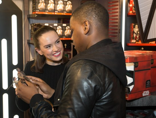 L-R Daisy Ridley and John Boyega stars of Star Wars:The Force Awakens with their own action figures inside the Disney Store on London's Oxford Street ahead of the midnight launch of the Star Wars: The Force Awakens memorabilia range. PRESS ASSOCIATION Photo. Picture date: Thursday September 3, 2015. Photo credit: David Parry/PA Wire