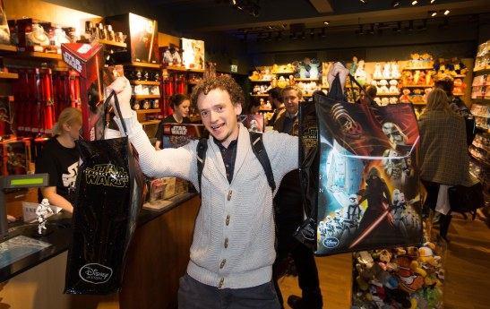 Thomas Blakey aged 26 from London is the first customer to purchase an item of the Star Wars: The Force Awakens memorabilia range, during the midnight launch, at the Disney Store on London's Oxford Street. PRESS ASSOCIATION Photo. Picture date: Thursday September 3, 2015. Photo credit: David Parry/PA Wire